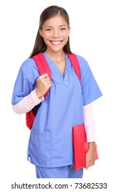 Medical student. Woman nurse or female medical student smiling with backpack and scrubs isolated on white background.