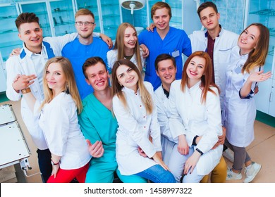 Medical students profession staff. multinational people - doctor, nurse and surgeon. A group of graduates of a medical university in a surgical room. Nursing School
