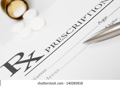 Medical stuff - prescription, pills and pen on table