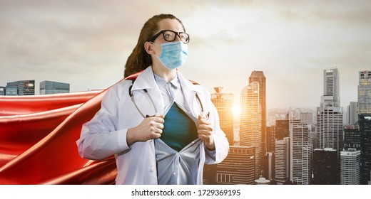 Medical superhero. Heroic doctor wearing mask and red cape fighting with epidemic in city. Young woman. Brave medical staff concept.