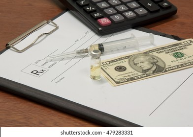 Medical syringe with medicine and US dollar notes symbol for health care costs or medical insurance