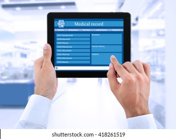Medical tablet in doctor hands on light background