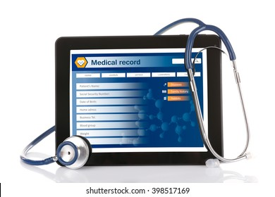Medical tablet with stethoscope isolated on white