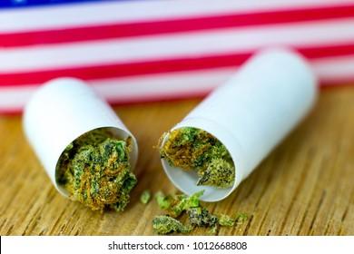 Medical Tablets pills of Cannabis - marijuana tablets, pills of cannabis, USA flag on fresh oak wood.