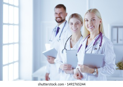 A medical team of doctors, man and women, isolated on white background