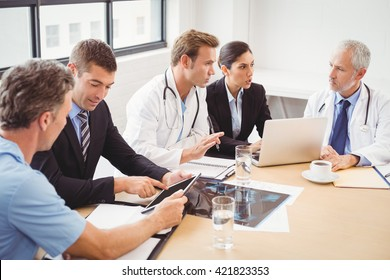 Medical team having a meeting in conference room in hospital