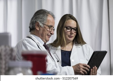Medical team looking at an ipad/tablet computer together