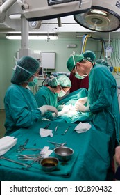 Medical team performing surgery on a young patient