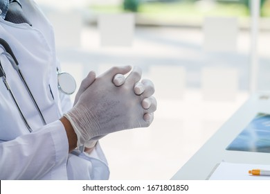 The medical team and quarantine control coronavirus covid-19 are praying to God requesting that the coronavirus covid-19 not spread beyond control. The doctor is praying to God with faith and hope.