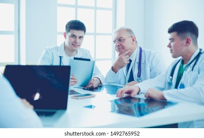 Medical team sitting and discussing at table