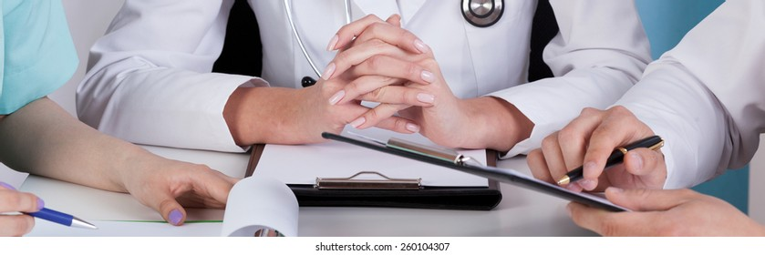 Medical team sitting at the table - panorama