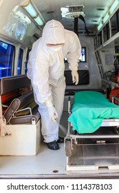 Medical team with  suit and equipment for protective Ebola in the hospital.