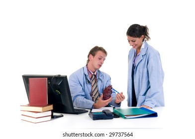 Medical team, two young male and female cardiologist  in the office.  Studio, white background.