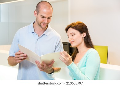 Medical technical assistant or doctor councelling a patient in clinic