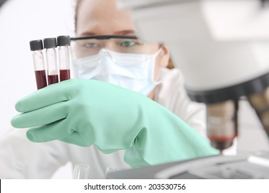 Medical technician examining blood test
