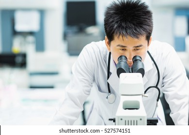medical technologist is working in the laboratory. Using a microscope for detect the objects that are too small for the naked eye. Picture for concept such as hospital, doctor, health and science.