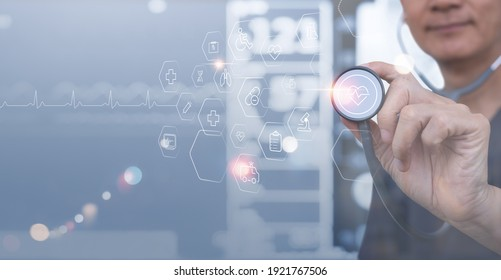 Medical technology background, virtual hospital, smart health, telemedicine concept. Doctor with stethoscope touching on medical technology icons on modern virtual screen, vital signs monitor data