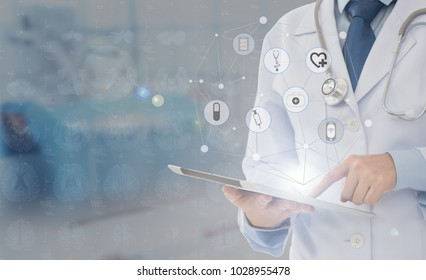medical technology communication concept. doctor using digital tablet with medical icon at operating room.