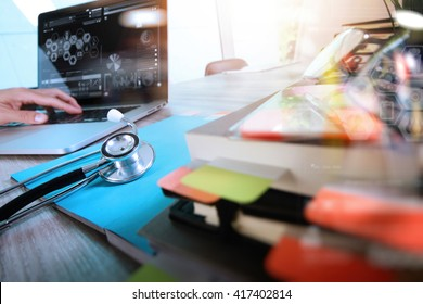 Medical technology concept. Doctor hand working with modern digital tablet and laptop computer with health care chart interface, Sun flare effect photo