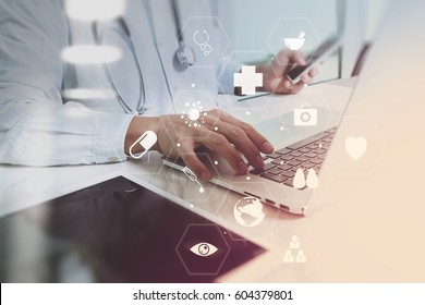 Medical technology concept. Doctor working with smart phone and stethoscope and digital tablet computer in modern office at hospital with computer interface icons diagram
