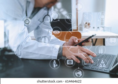 Medical technology concept. Doctor working with smart phone and stethoscope and digital tablet computer in modern office at hospital with virtual digital graphic icons diagram