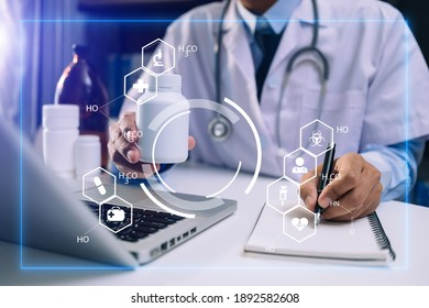 medical technology concept,smart doctor hand working with modern laptop computer with his team virtual icon diagram