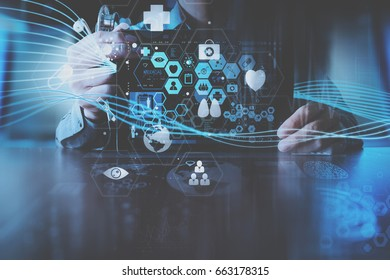 medical technology concept,smart doctor hand working with modern laptop computer in modern office with virtual icon diagram
