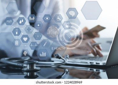 Medical technology, E Health, Mobile health application, Telemedicine concept. Doctor working on laptop computer and smartphone with health icons on virtual screen