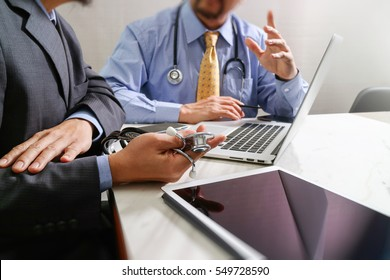 Medical technology network team meeting concept. Doctor hand working smart phone modern digital tablet laptop computer graphics chart interface, sun flare effect photo