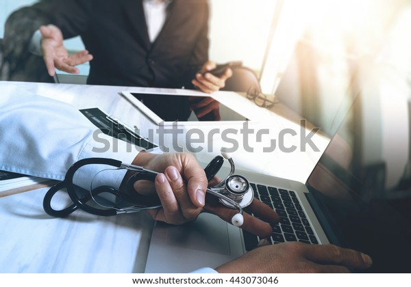 Medical technology network team meeting concept. Doctor hand working smart phone modern digital tablet laptop computer graphics chart interface, double exposure effect photo