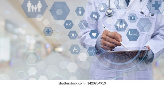 Medical technology, telemedicine, e-health, medical online, electronics health record system concept. male doctor working on digital tablet computer with web icons technology on virtual screen.
