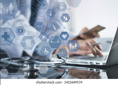 Medical technology, telemedicine, e-health, medical online, electronics health record system, virtual hospital concept. male doctor working mobile smart phone and laptop computer with web icons