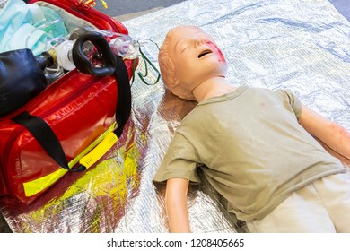 Medical teenager puppet lies injured on the ground