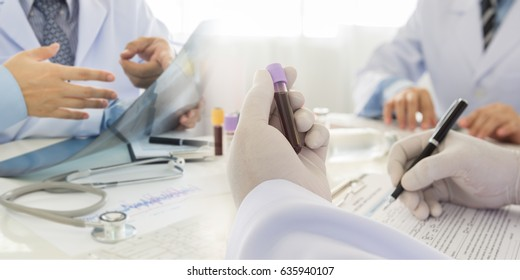 Medical test, Blood sample in tube with team doctors diagnose for treatment patient.
