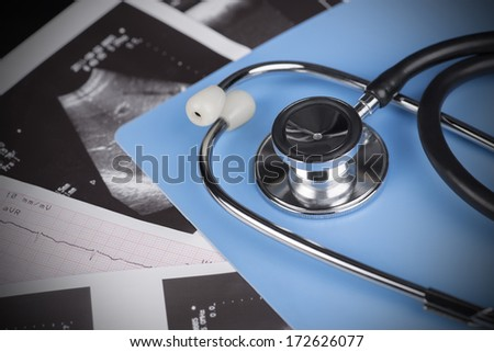 Medical Test - stethoscope, ultrasound shot and cardiogram.