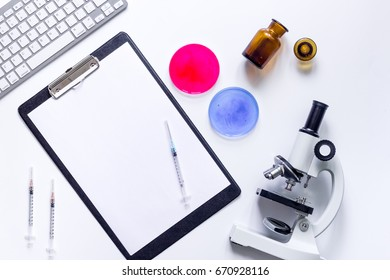Medical tests. Work table of doctor witn microscope, Petri dish, syringe on white background top view mockup