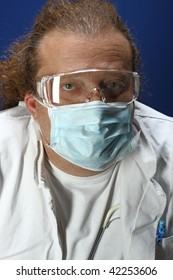 Medical theme - serious doctor working in a laboratory. Studio shot. Blue background.