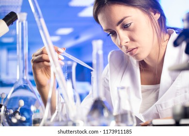 Medical theme. Young female doctor working in laboratory. Research and development concept.