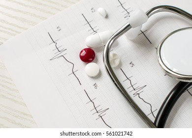 medical tools: stethoscope, cardiogram and medicines