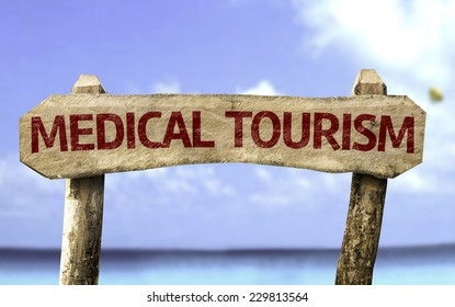 Medical Tourism sign with a beach on background