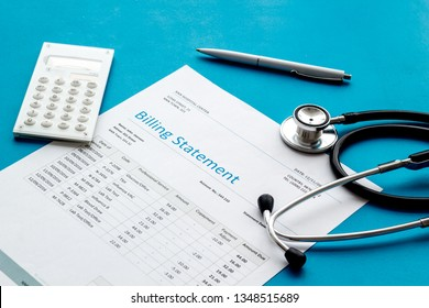 medical treatment bill, calculator and phonendoscope on blue background