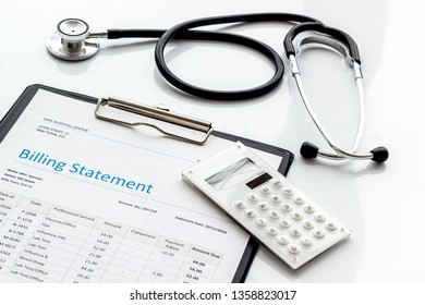 medical treatment bill, calculator and phonendoscope on white background