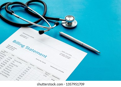 medical treatment bill and phonendoscope on blue background