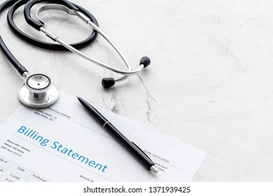 medical treatment bill and phonendoscope on white background