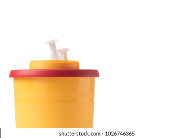 Medical waste container with syringe isolated on white