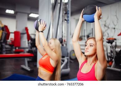 Medical Woman are engaged with ball in gym, concept body fitness, therapeutic medecine for back.