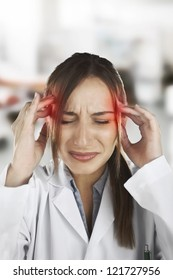 Medical woman with headache at hospital. Stress woman young doctor