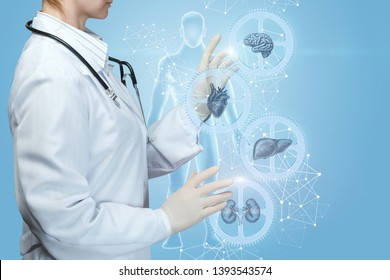 A medical worker adjusts a complex mechanism of health . A closeup of doctor operating with internal organs treatment mechanism of cogwheels with icons and models inside at digital human.