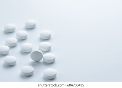 Medical,pharmacy theme background concept. White pills on white background.