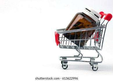 Medical,pharmacy theme background concept.Many drugs and pills in glass container in shopping cart on white background.